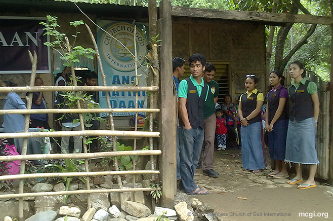 Youths lining up at the entrance to greet brethren and guests at the Locale of Magata in Rizal Province.