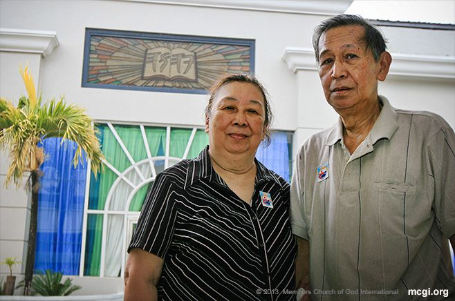 Standing before the MCGI Chapel, the Peralta couple went to Apalit, Pampanga, Philippines on March 22, 2013 to be baptized in the Church of God International (MCGI).