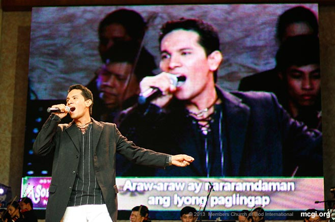 In the first finals of the bi-annual ASOP Music Festival of MCGI, an interpreter from Laguna Province belts the high parts a song entry during the  ASOP Mid-Year Finals in 2010.