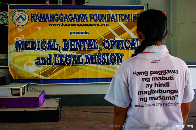 """An MCGI member at the medical mission on February 24, 2014 in Quezon City wearing a Just One Day shirt that says in English, """"Doing good will not bring forth evil."""""""