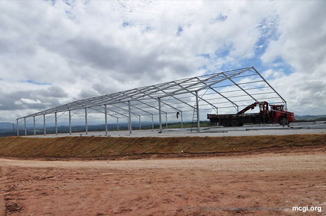 Metal frames of MCGI's Convention Center in South America stand tall as the venue awaits completion to accommodate delegates from various countries around the globe.