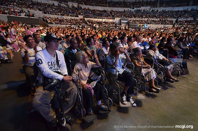 Right before the stage, disabled persons seat in front of the huge crowd at the Smart-Araneta Coliseum for the Worldwide Bible Exposition of MCGI on October 30, 2014 in celebration of The Old Path's 34th anniversary. (Photo courtesy of PVI)