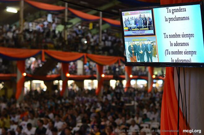 MCGI brethren in South America are flashed on the screen as well as the Portuguese lyrics of a song of praise at the ADD Convention Center in Apalit, Pampanga. (Photo courtesy of Photoville International)