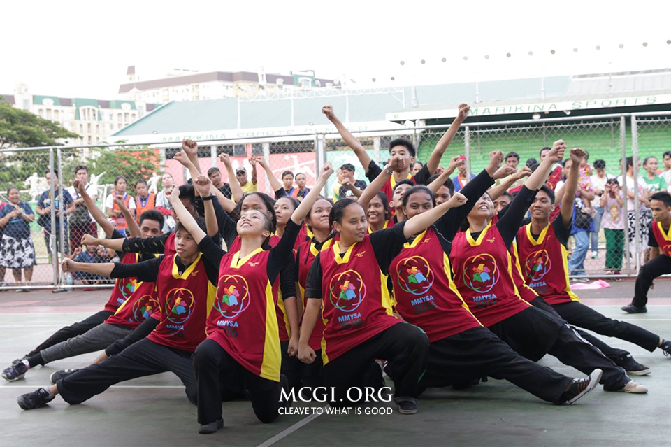A group of Youth Ministry members from Metro Manila pose proudly after finishing their cheerdance entry. Photo by Photoville International)